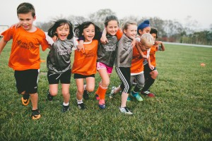 Group-of-kids-running_arms-around-each-other_laughing_nonaction
