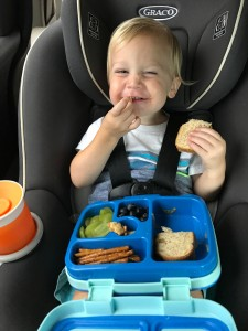 It's also great for eating lunch on the go. This is my son Royce using his Bentgo Kids Box on a weekend road trip.