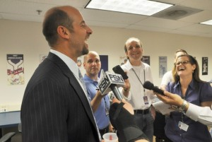 "Carroll in the media ""scrum"" talking to former Braves pitcher John Smoltz the night the Braves retired his jersey"